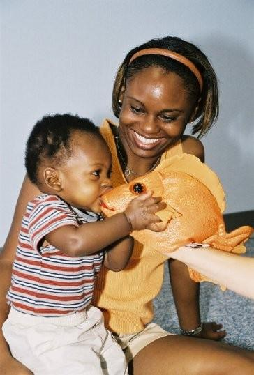 baby with fish puppet