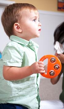 Boy with baby tambourine