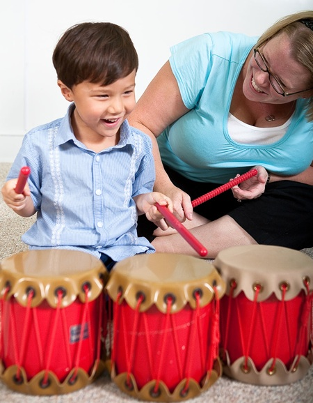 Boy with three drums