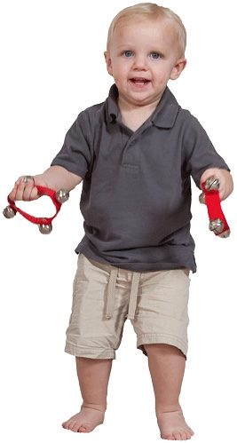 Standing boy holding wrist bells