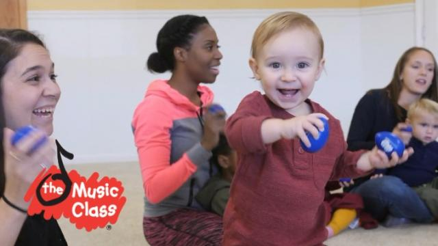 smiling child with musical toy